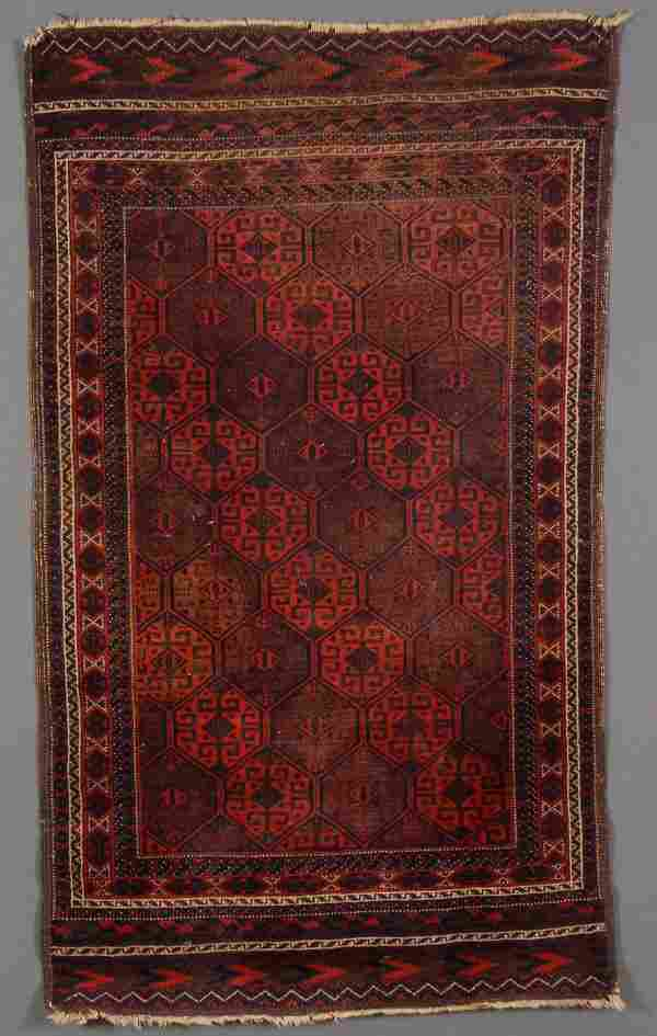 A PERSIAN HAND WOVEN ORIENTAL RUG,