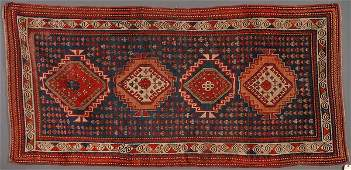 A PERSIAN KAZAK HAND WOVEN ORIENTAL RUG,