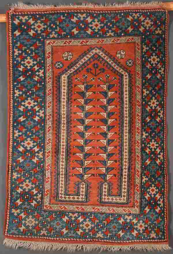 A PERSIAN HAND WOVEN ORIENTAL RUG, 20TH CENTURY.