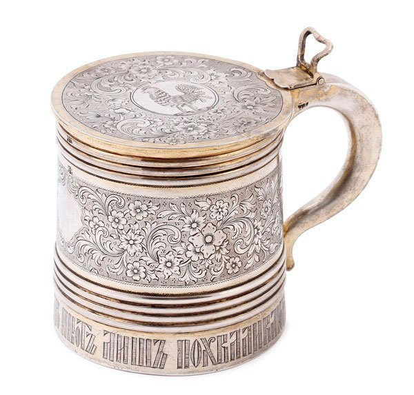 A RUSSIAN SILVER GILT AND ENGRAVED TANKARD