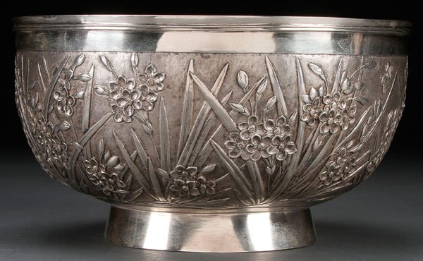 A CHINESE EXPORT SILVER FLORAL REPOUSSE BOWL