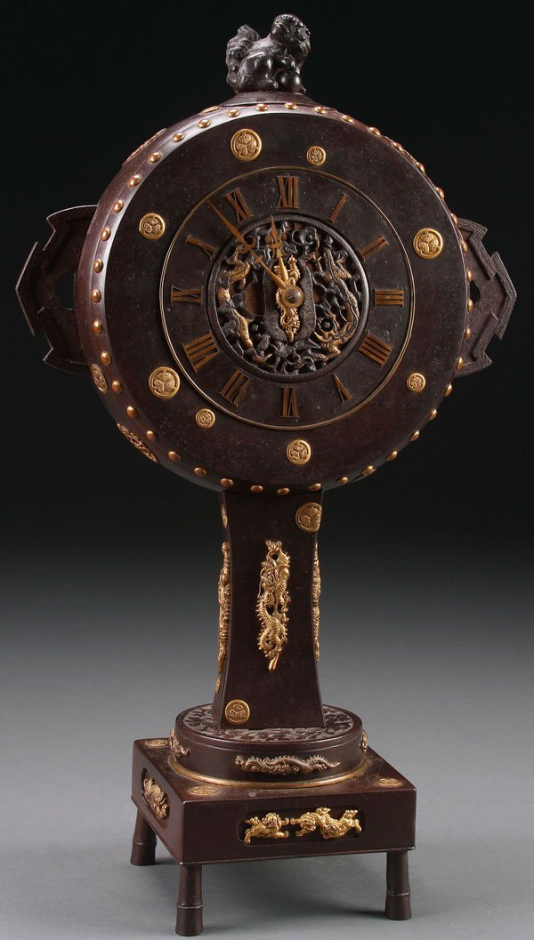 A JAPANESE PATINATED IRON, BRONZE, PARCEL GILT CLOCK