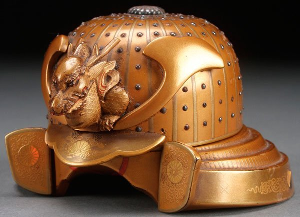 A JAPANESE GILT LACQUER KABUTO FORM LIDDED BOX, MEIJI