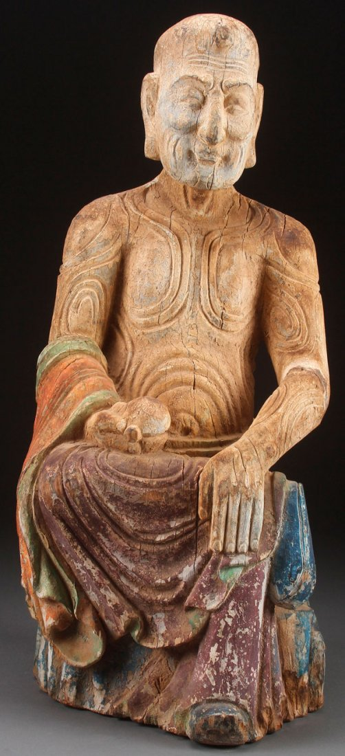A LARGE CARVED WOOD BUDDHA RELIQUARY FIGURE