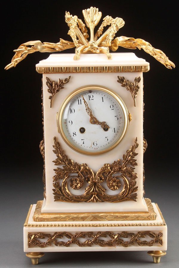 A FRENCH LOUIS XVI STYLE GILT BRONZE MANTLE CLOCK