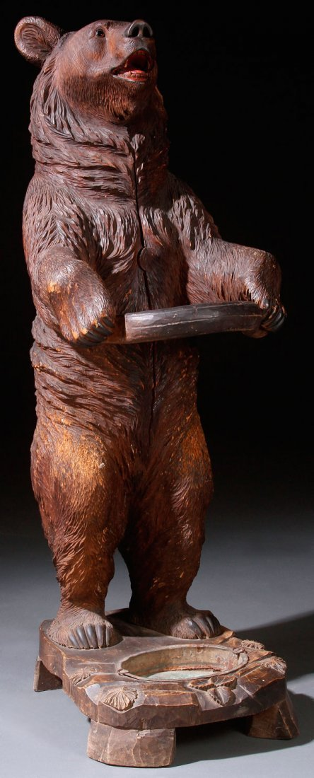 A BLACK FOREST SWISS CARVED BEAR UMBRELLA STAND
