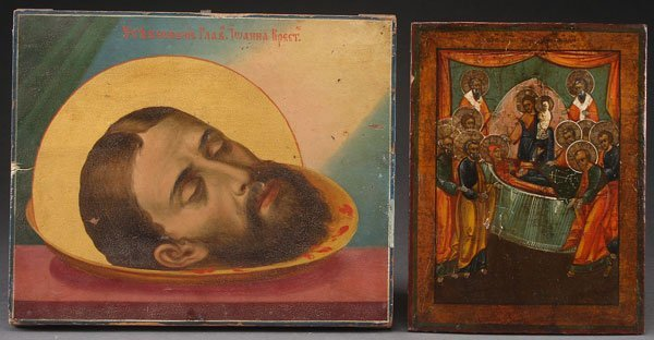 A PAIR OF RUSSIAN ICONS, 19TH CENTURY. Comprising