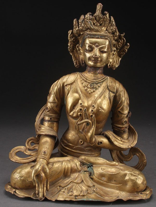 A TIBETAN GILT COPPER REPOUSSÉ  WHITE TARA FIGURE