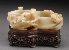 A CHINESE CARVED WHITE JADE DOUBLE WATER COUPE