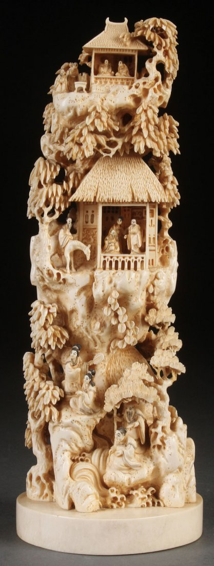 A VERY FINE CHINESE CARVED IVORY SCENIC GROUP