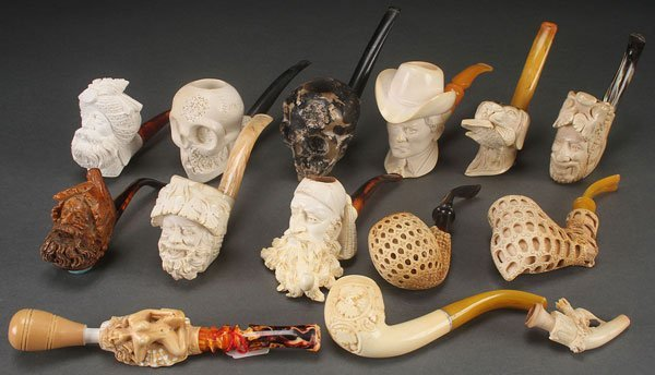 AN 18 PIECE COLLECTION OF CARVED MEERSCHAUM