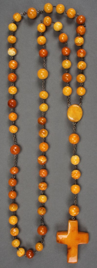 AN AMBER ROSARY PROBABLY POLISH, 19TH CENTURY