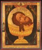 A LARGE RUSSIAN ICON HEAD OF ST JOHN 19TH C