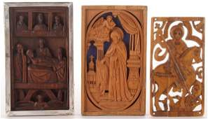 A PAIR OF CARVED WOOD RUSSIAN MONASTERY ICONS