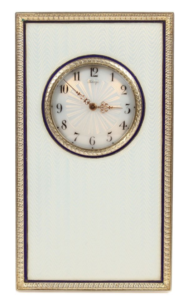 A FABERGE SILVER GILT AND ENAMEL DESK CLOCK