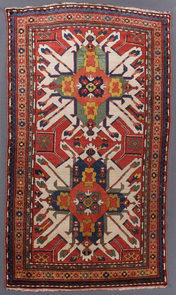 A VERY FINE CAUCASIAN EAGLE KAZAK ORIENTAL RUG