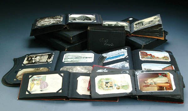 683: 10 VINTAGE POSTCARD ALBUMS with a large variety o