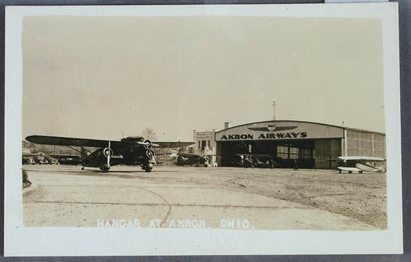 706: AN AKRON AIRWAYS REAL PHOTO POSTCARD, showing han