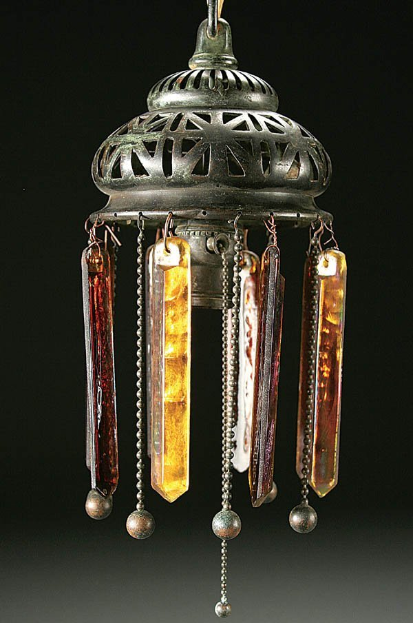 500: A TIFFANY FAVRILE GLASS AND BRONZE HANGING LAMP c