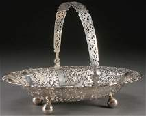 CHINESE CARVED SILVER HANDLED FRUIT BASKET
