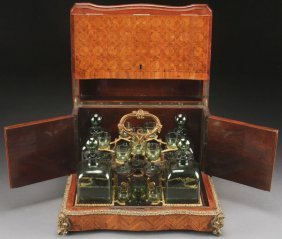 A French Parquetry And Gilt Bronze Cased Tantalus