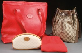 A Group Of Three Gucci Handbags. Comprising A Red