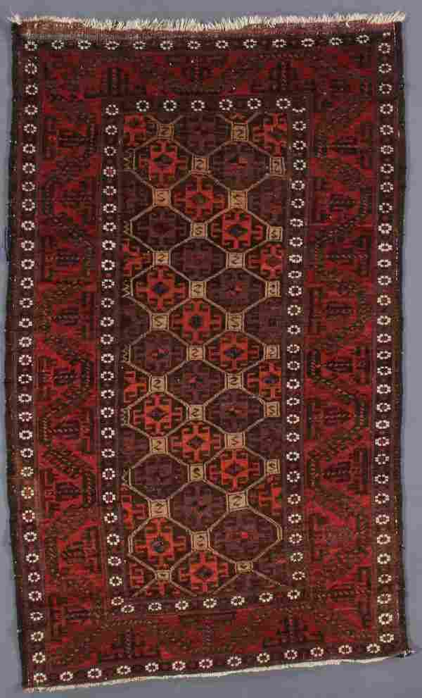 A TURKOMAN RUG AND CHUVAL, EARLY 20TH CENTURY.