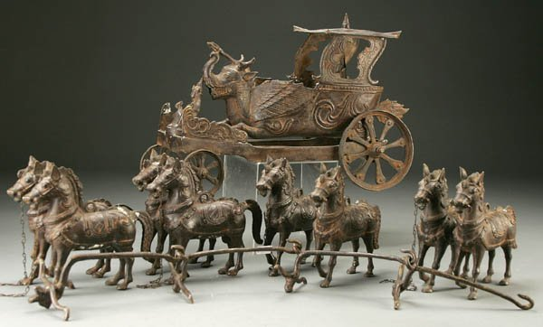834: AN ORIENTAL BRONZE TOY PROCESSIONAL CART probably