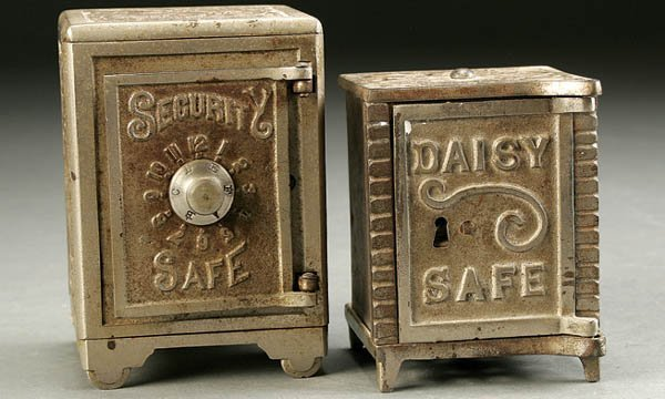 854: TWO CAST IRON SAFE BANKS early 20th century, the