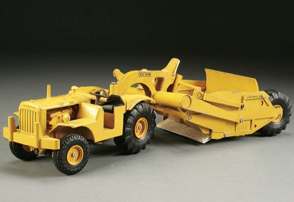877: A VERY FINE REUHL PRODUCTS TOY CATERPILLAR DW 10