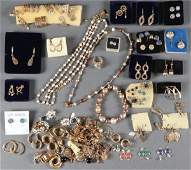 A LARGE COLLECTION OF MOSTLY 14 KT GOLD EARRINGS