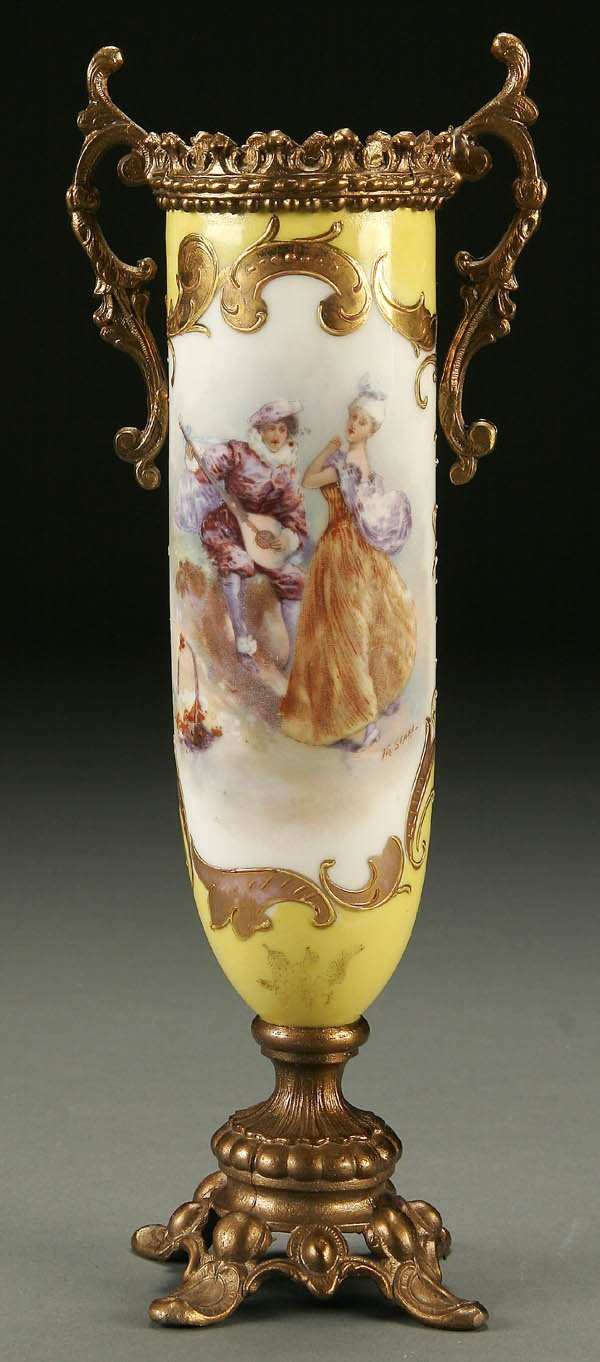 754: A FRENCH ORMOLU MOUNTED PORCELAIN URN early 20th