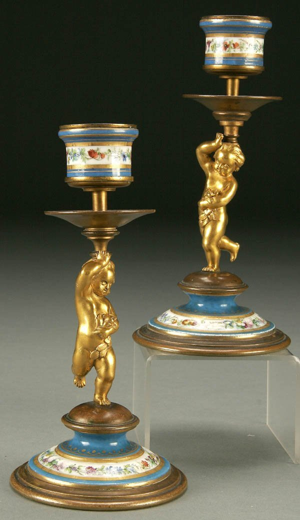755: A PAIR OF FRENCH SEVRES STYLE CANDLE STANDS: GILT