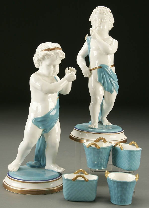 765: A PAIR OF 19TH CENTURY ENGLISH CERAMIC PUTTO hand