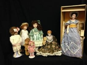 Lot 0f 6 Porcelain Dolls  And 1 Wood Doll Shackman Doll