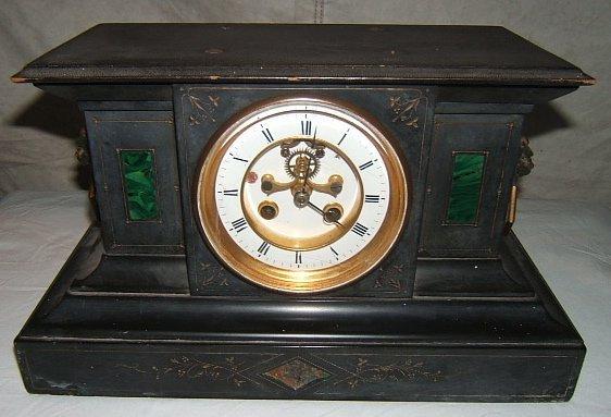 7: Antique Slate Mantel Clock with Lions