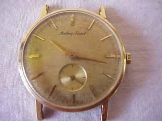 5: 18 kt. Gold Watch