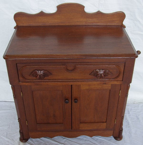 219: Victorian Heavily Carved Walnut Commode