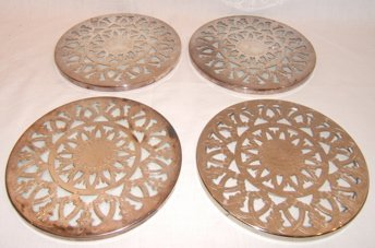 21: 4 Antique Silverplate Trivets