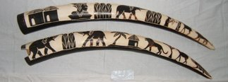 506: 2 Antique African Ivory  Animal/People Design