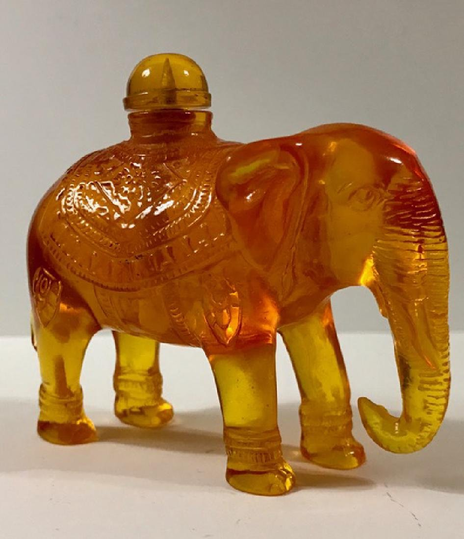 Ornate Carved Chinese Amber Elephant Snuff Bottle