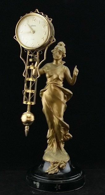 Vintage Diana Spelter Swinging Clock