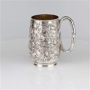 A Large Silver Mug by Wang Hing, for Tiffany.