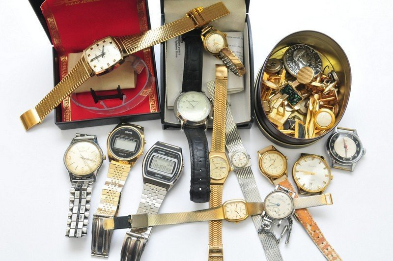 A collection of assorted wristwatches and cufflinks inc