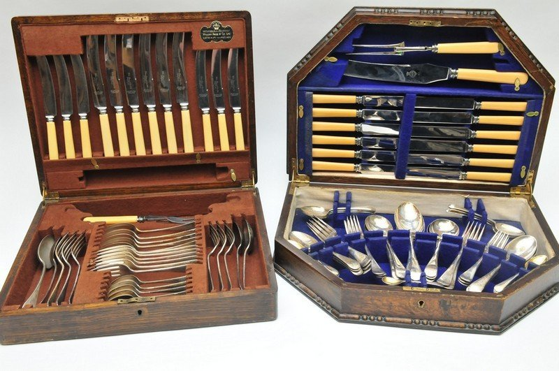 Two oak cased sets of silver plated cutlery