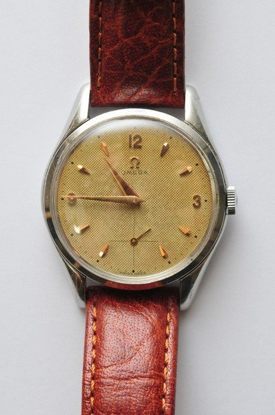 A gents oversize Omega wristwatch having waffle dial wi