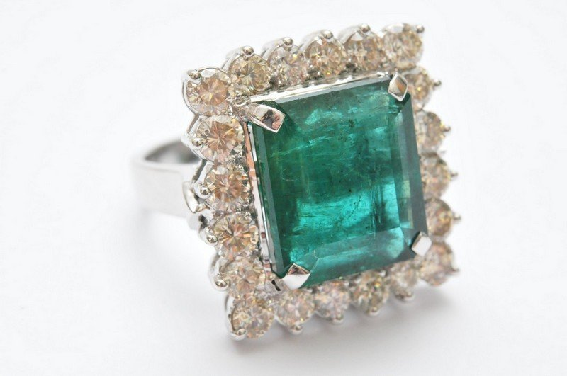 A ladies 14ct white gold ring set with a large emerald