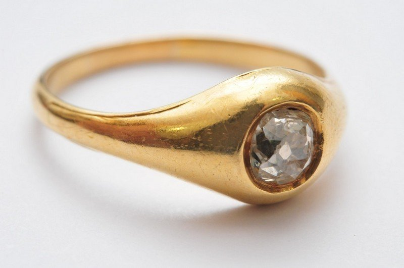 A 19th century gold ring set with a single old cut diam