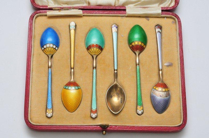 A Cased set of silver enamel spoons