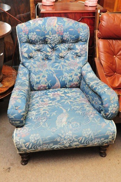 A large Victorian open arm chair with blue oriental fab